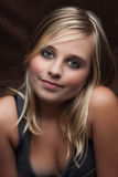 Beautiful girl. A young likeable beautiful girl, portrait with dark background Stock Photo