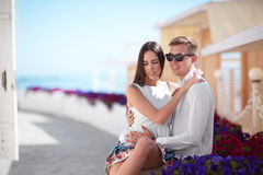 A beautiful girl and a young man in sunglasses. Lovers having fun on a summer holiday. Happy honeymoon of a fall-in-love couple. Cute couple laughing outdoors Stock Photo
