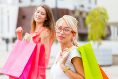 Beautiful Girlfriends Gone Shopping Royalty Free Stock Images