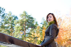 Beautiful girlin in autumn forest royalty free stock photography