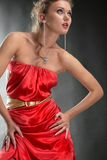Beautiful girlin a red dress Stock Images