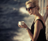 Beautiful girlresting woman with cup of coffee. Beautiful lady resting woman with cup of coffee Stock Photo