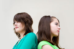Beautiful girls back to back Stock Images