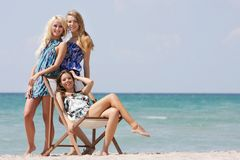 Beautiful girls on beach Stock Images