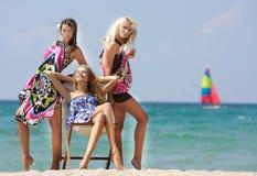 Beautiful girls on beach Stock Photos