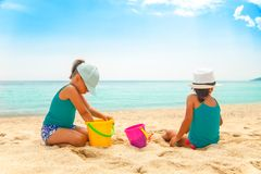 Beautiful girls on the beach royalty free stock photography