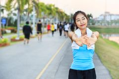 Beautiful girls. Beautiful girls are exercising at the park stock images