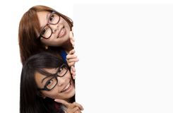 Beautiful Girls  behind the  white board Stock Images
