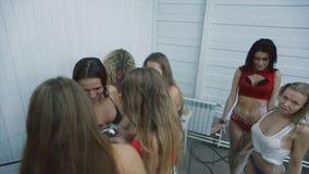 Beautiful girls in bikinis foam wash in the shower stock video