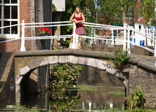 Beautiful girls on bridge. In very romantic place. This place is locate in Delft, Netherlands Royalty Free Stock Photography