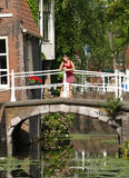 Beautiful girls on bridge. In very romantic place. This place is locate in Delft, Netherlands stock photo