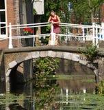 Beautiful girls on bridge royalty free stock photography