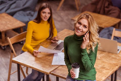 Beautiful girls in cafe Royalty Free Stock Photo
