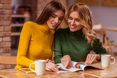Beautiful girls in cafe Stock Image