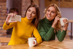 Beautiful girls in cafe Stock Images