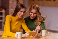 Beautiful girls in cafe Royalty Free Stock Photos