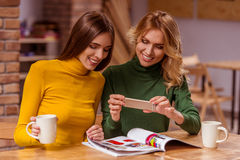 Beautiful girls in cafe Royalty Free Stock Images