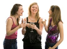 Beautiful girls celebrating. Isolated in white Stock Images