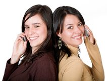 Beautiful girls on cell phones Royalty Free Stock Photo