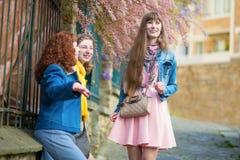Beautiful girls chatting on a Parisian street Royalty Free Stock Image