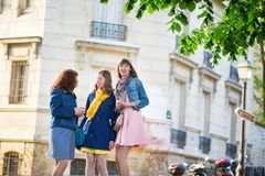 Beautiful girls chatting on a Parisian street Royalty Free Stock Photos