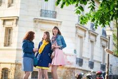 Beautiful girls chatting on a Parisian street Royalty Free Stock Photos