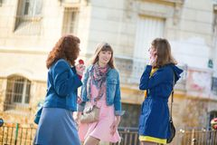 Beautiful girls chatting on a Parisian street Royalty Free Stock Images