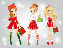 Beautiful Girls With Christmas Bags Stock Photography