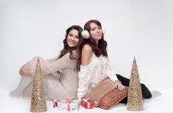 Beautiful girls with christmas presents Stock Images