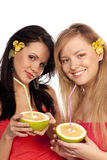 Beautiful girls with citruses Stock Photos