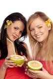 Beautiful girls with citruses Stock Photos