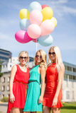 Beautiful girls with colorful balloons in the city Stock Photo