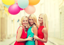 Beautiful girls with colorful balloons in the city Royalty Free Stock Photography