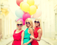 Beautiful girls with colorful balloons in the city Royalty Free Stock Image