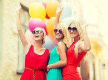 Beautiful girls with colorful balloons in the city Royalty Free Stock Photos