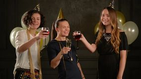 Beautiful Girls Congratulate Their Friend with a Birthday. Three Women with Glasses of Champagne and Wine Having Fun stock footage