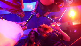 Beautiful girls dancing at a party with glasses in their hands - a disco at a birthday party stock footage