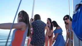 Beautiful girls dancing on a yacht - party and bachelorette party.  stock video
