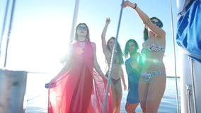 Beautiful girls dancing on a yacht - party and bachelorette party.  stock footage