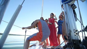 Beautiful girls dancing on a yacht - party and bachelorette party stock video