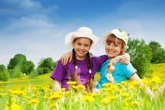 Beautiful girls in dandelion fields Stock Image