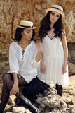 Beautiful girls with dark hair wears casual elegant clothes and hat Royalty Free Stock Image