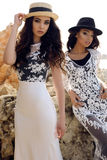 Beautiful girls with dark hair wears casual elegant clothes and hat Stock Photos