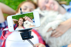 Beautiful girls with dog taken pictures of her self Stock Photo