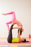Beautiful girls doing acrobatic yoga Royalty Free Stock Image