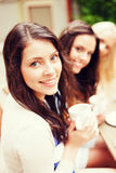Beautiful girls drinking coffee in cafe. Holidays and tourism concept - beautiful girls drinking coffee in cafe Stock Photography