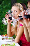 Beautiful girls drinking wine Stock Photography