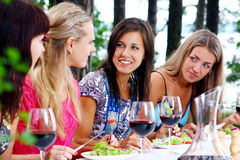 Beautiful girls drinking wine Stock Photo