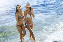 Beautiful girls enjoying summer and sea water Stock Image