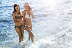 Beautiful girls enjoying summer and sea water Stock Photo